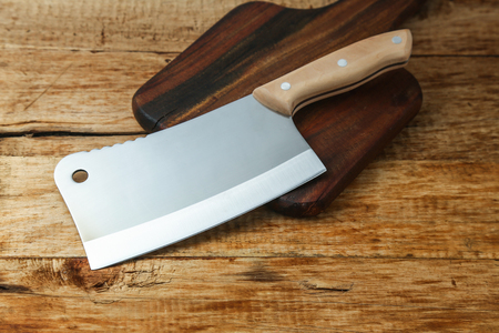 cleaver knife on wooden board