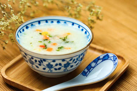 vegetable porridge in blue and white porcelain bowl