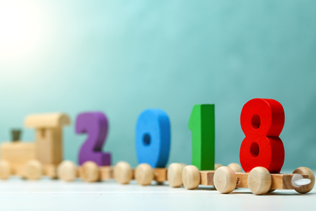 2018 happy new year,wooden toy train carrying numbers Stock Photo
