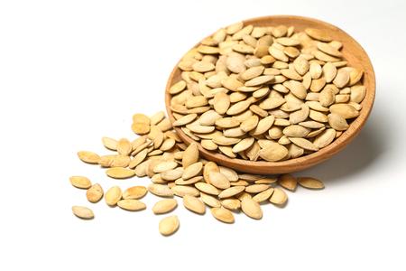 pumpkin seeds in wooden plate isolated on white background Standard-Bild
