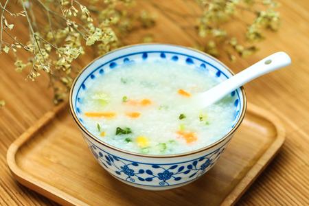 vegetable porridge in blue and white porcelain bowl