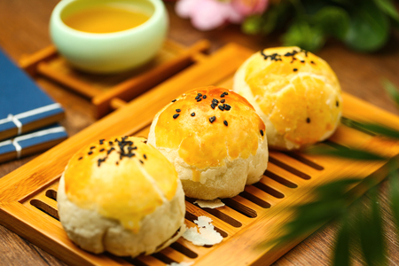 egg yolk puff and tea on bamboo plate 스톡 콘텐츠