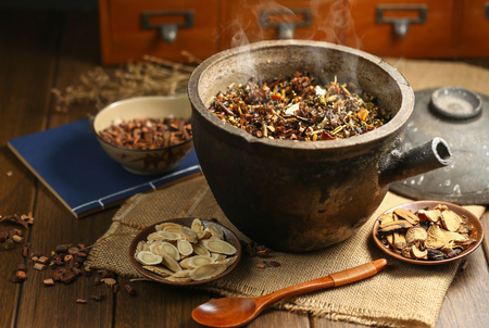 Chinese traditional herbal medicine in casserole Stock Photo