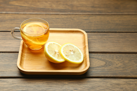 lemon black tea in glass cup on wooden table  Stock Photo