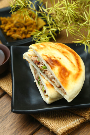 chinese hamburger in black plate Stock Photo