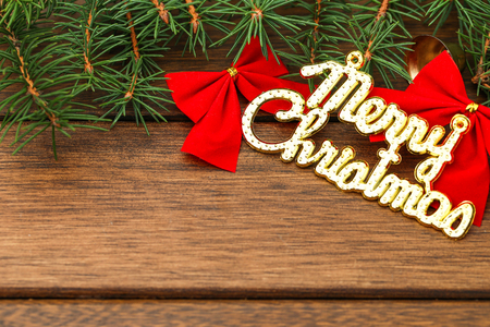 Merry Christmas background,pine branches and decorations on wooden table with copy space