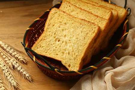 whole wheat bread on wooden table Stock Photo