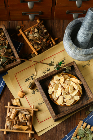 Chinese traditional herbal medicine in steelyard. Translation reads as chinese herbal therapy. Stock Photo