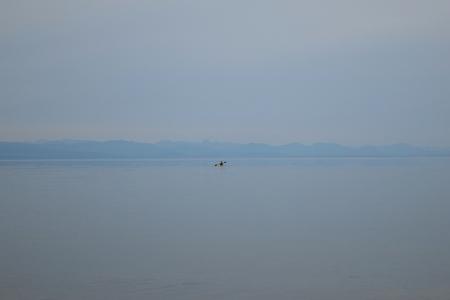 kayaker: Ocean kayaker in the background
