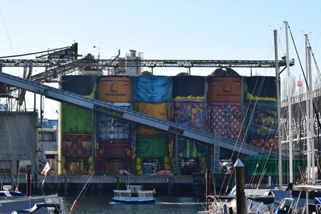 Murals on cement silos  - Granville Island - Vancouver BC, Canada.