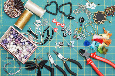 pendent: Accessories for hand made costume jewelry. Tools. Beads, pendent, chain. Top view. Work place. Stock Photo
