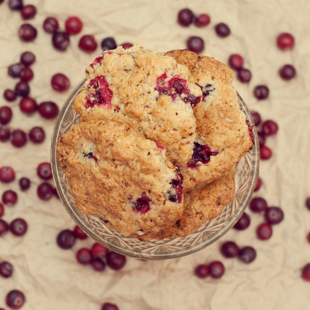 high calorie foods: oatmeal cookies with cranberries  or lingonberries blurred background