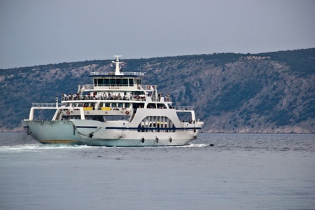 Adriatic ferry boat, publice sea transportation, Cres, Croatia photo