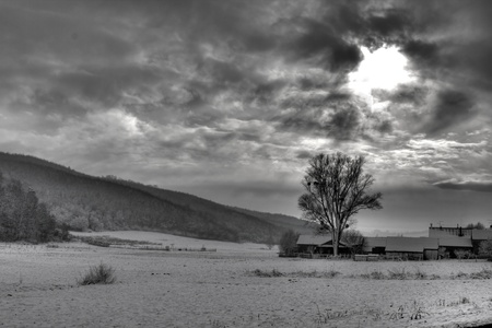 snow break: BW photo of dramatic sky, and sun rays through the clouds