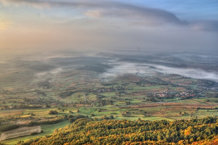 View from Kalnik mountain - fog in the valley, beautiful green landscape photo