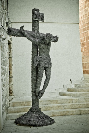 Barb wire Jesus Christ crusifixcion - Vodice, Croatia photo