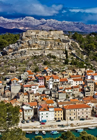 Novigrad dalmatinski with fortress, and Velebit mountain in back Stock Photo - 12888843