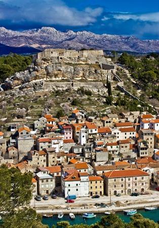 Novigrad dalmatinski with fortress, and Velebit mountain in back Stock Photo - 12888843