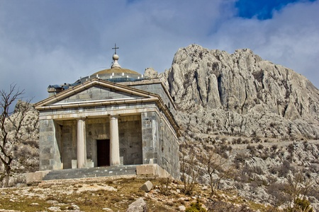 Stone church on Velebit mountain near Tulove grede, Croatia photo