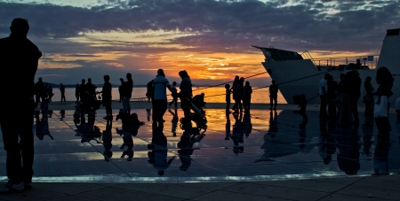 Greetings to the sun installation in Zadar, people silhouette at sunset Stock Photo