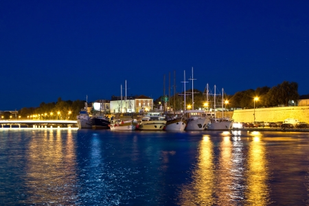 Fishing boats in safe harbor on evening in Zadar, Croatia, Dalmatia photo