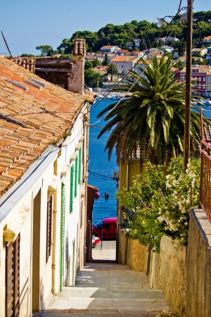 Colorful narrow street in Mali Losinj, Dalmatia, Croatia