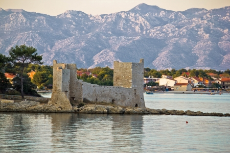 Island of Vir fortress ruins with Velebit mountain in background, Dalmatia, Croatia