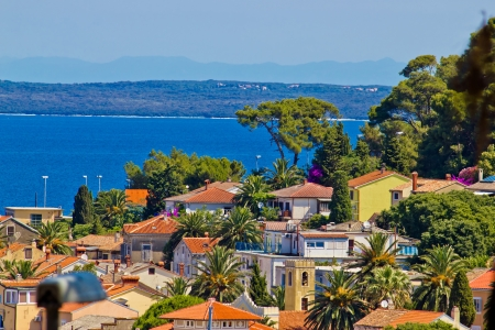 Colorful coastal town of Mali losinj residential area by the blue sea photo
