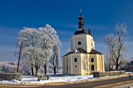 Catholic church in town of Krizevci winter landscape, Croatia photo