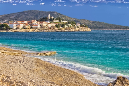 Town of Primosten turquoise sea and pebble beach, Dalmatia, Croatia