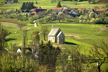 kalnik: Stone made church in green nature, Kalnik mountain, Croatia Stock Photo