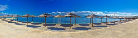Pebble beach and umbrellas panoramic view, Island of Vir, Dalmatia, Croatia photo