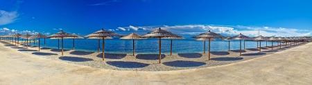 Pebble beach and umbrellas panoramic view, Island of Vir, Dalmatia, Croatia