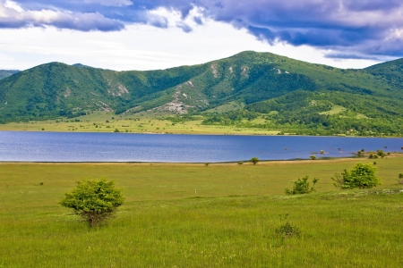 Lika region mountain and lake landscape, Croatia photo