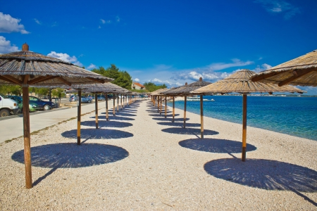 Island of Vir beach umbrellas, Dalmatia, croatia Stock Photo