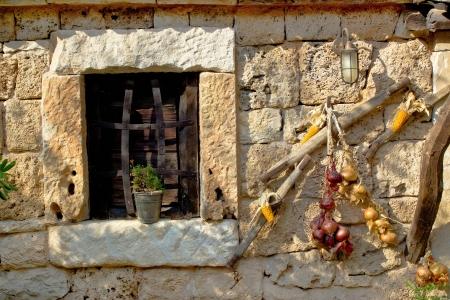 Traditional dalmatian stone house window with ornaments, Dalmatia, Croatia