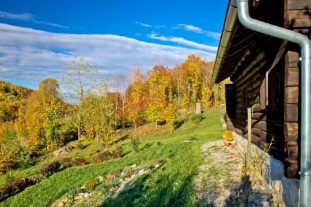 conspiratorial: Wooden lodge in autumn mountain nature, Kalnik mountain world war 2 hospital in Croatia