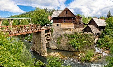Village of Rastoke river canyon and stone architecture, Croatia Фото со стока