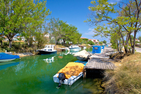 boats on the river in Nin, Croatia photo