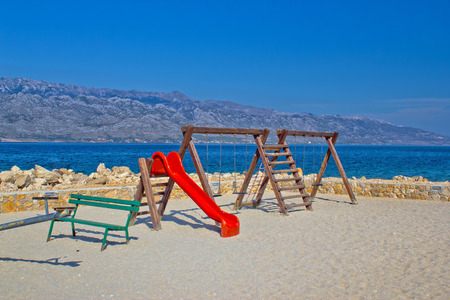 Childrens playground by the sea, Dalmatia, Croatia photo