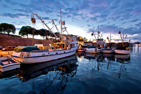 Fishing boats on colorful sunset in Zadar, Croatia