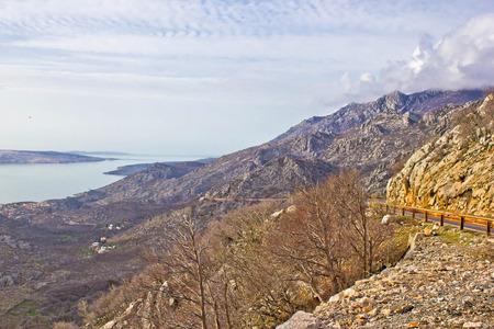 Velebit mountain cliffs and road, Coatia photo