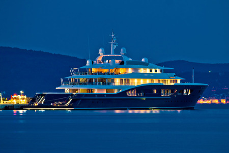 Luxury yacht blue evening view on mediterranean coas Фото со стока