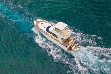 Yacht sailing on blue sea aerial view