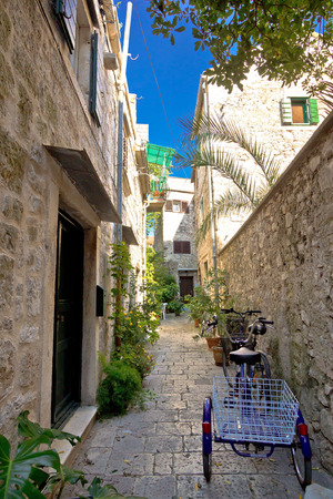 starigrad: Narrow mediterranean stone street in Stari Grad, Island of Hvar, Croatia Stock Photo