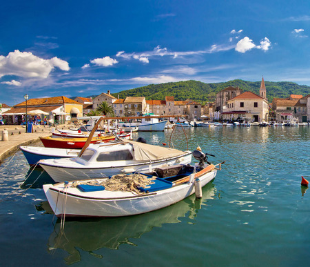 starigrad: Colorful Stari Grad on Hvar island waterfront view, square composition, Dalmatia, Croatia