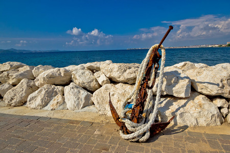 Old rusty anchor by the sea in Dalmatia, Croatia Stock Photo