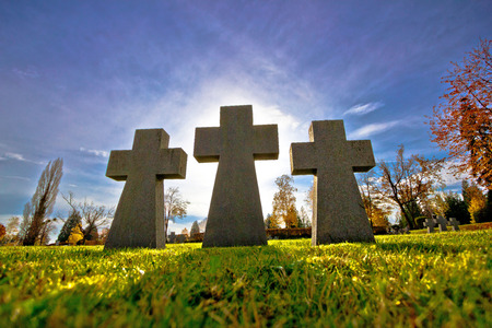 empty tomb: Graveyard three crosses on green meadow silhouette view Stock Photo