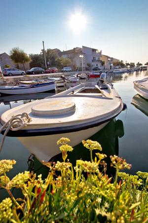 Diklo village waterfront boat in marina view, Dalmatia, Croatia photo