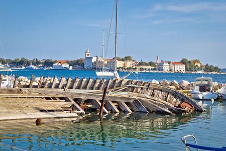 Old sinked wooden ship in Zadar harbor, Dalmatia, Croatia photo